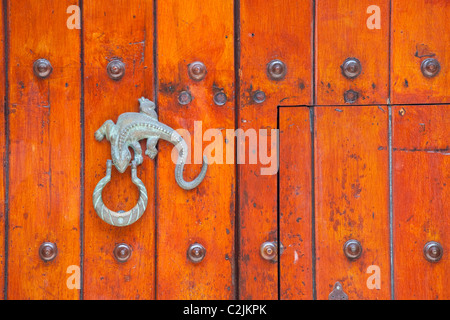 Door knocker in the old city, Cartagena, Colombia - Stock Photo