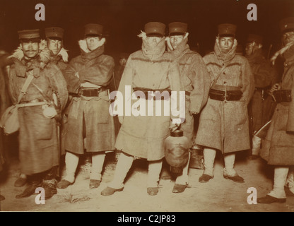 Japanese soldiers waiting on a beach to entrain to Seoul - Stock Photo