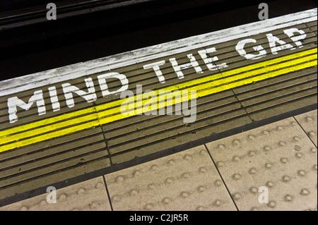 Mind the Gap warning on the edge of a London Underground station's platform, London, England - Stock Photo