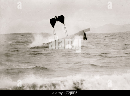 airplane of pilot and daredevil Hugh Armstrong Robinson (1881-1963) making a crash landing on water near Nice, France, - Stock Photo
