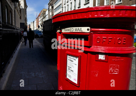 Red post office letterbox in London, England, UK - Stock Photo