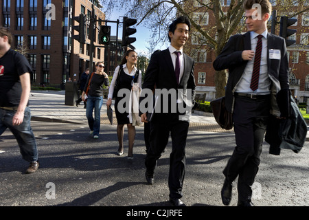 Pedestrians crossing street in London, England, UK - Stock Photo