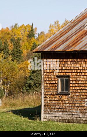 Weathered old barn with rusty tin roof, near Campbelton, New Brunswick, Canada - Stock Photo