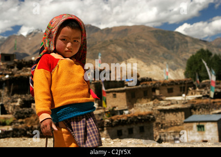 Kid standing on the roof top and looking inquisitive in village Nako, Kinnaur Himachal Pradesh India - Stock Photo