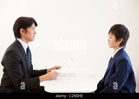 Junior High School Boy and Teacher Having a Meeting - Stock Photo