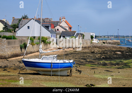 Boat at low tide in the port of Port Louis, the Morbihan department in Brittany in north-western France - Stock Photo