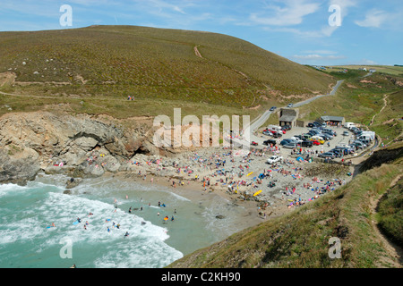 Chapel Porth beach in Cornwall UK near high tide. - Stock Photo