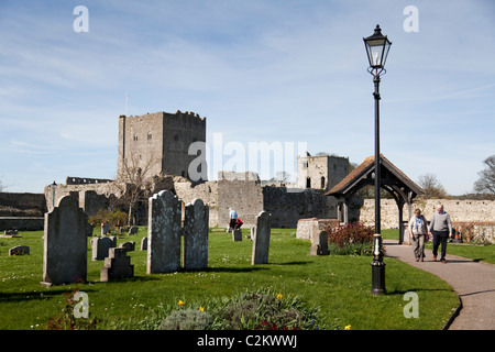 inner Bailey of Portchester Castle and and gravestones of the 12C priory - Stock Photo
