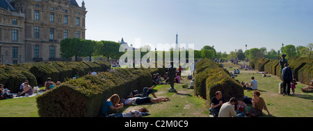 Paris, France, People Enjoying Warm Weather on Lawn in Tuileries Garden, Jardin des Tuileries, (Near Louvre Museum) - Stock Photo