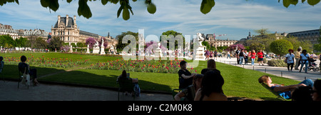 Paris, France, People Enjoying Warm Weather on Lawn in Tuileries Garden, Jardin des Tuileries, (Near Louvre Museum) - Stock Photo
