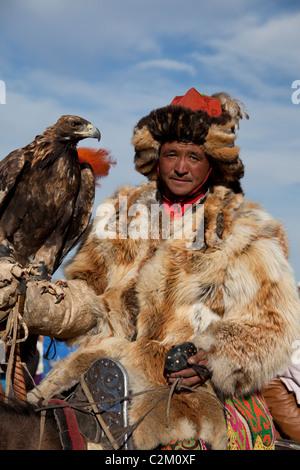 Mongolian Kazakh Eagle Hunter, Eagle Festival, Western Region, Mongolia - Stock Photo