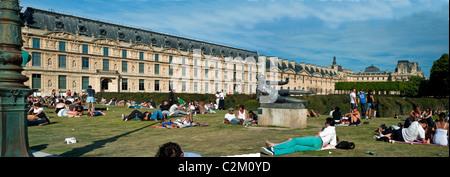 Paris, France, People Enjoying Warm Weather on Lawn in Tuileries Garden, Jardin des Tuileries, Near Louvre Museum, - Stock Photo