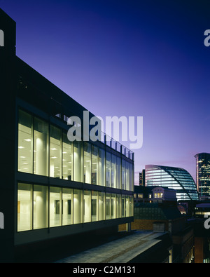 41 Lothbury, London. Offices integrating existing listed interior. Exterior at dusk. - Stock Photo