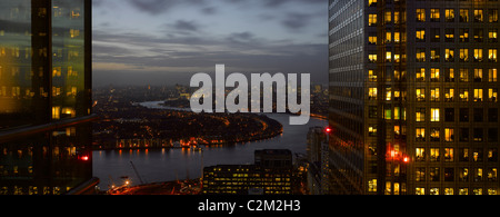 London panorama from Citigroup Tower at dusk with lights in windows towards the River Thames. - Stock Photo