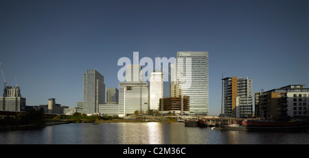 Canary Wharf, Docklands, London. Overall from the east looking west at sunrise. - Stock Photo