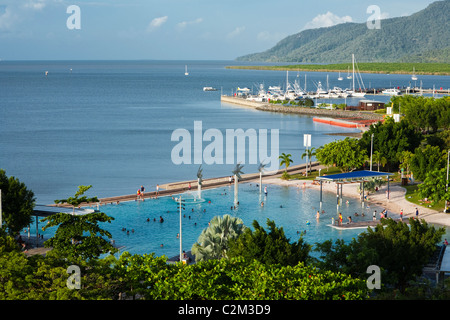 Swimmers at the Esplanade Lagoon. Cairns, Queensland, Australia - Stock Photo
