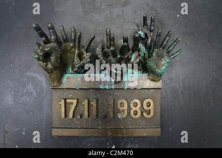 A commemorative bronze sculpture at the place where Czech students met up with riot police during their peaceful - Stock Photo
