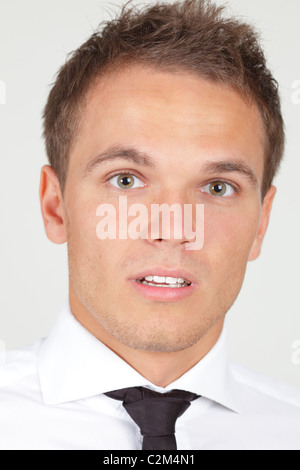 Portrait of afraid looking businessman isolated on white - Stock Photo
