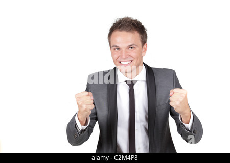 One happy energetic businessman with his arms raised. - Stock Photo