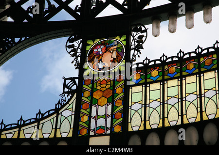 Art Nouveau stained glass decoration by Alfons also Alphonse Mucha at the main entrance to Obecni Dum Municipal - Stock Photo