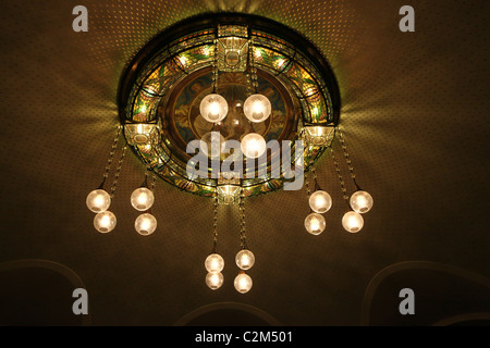 Decorated ceiling in Art Nouveau design at Obecni Dum Municipal House a civic building that houses Smetana Hall, - Stock Photo
