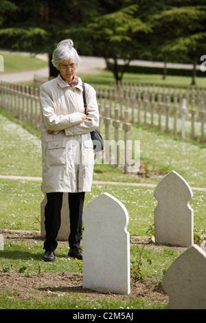 A tourist visiting tombstones of Muslim soldiers, Verdun, France - Stock Photo