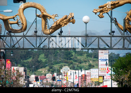 Chinese dragons on ceremonial gateway entrance to Chinatown in downtown Los Angeles California - Stock Photo