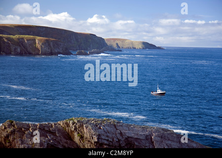 Sea angling boat near Erris Head, County Mayo, Ireland. - Stock Photo