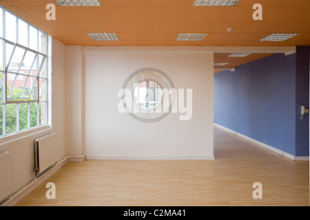 Renovated small empty office units with wooden floors - Stock Photo