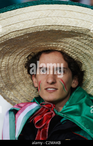 A Mexico supporter in the stands at Soccer City Stadium prior to a 2010 World Cup round of 16 match between Mexico - Stock Photo