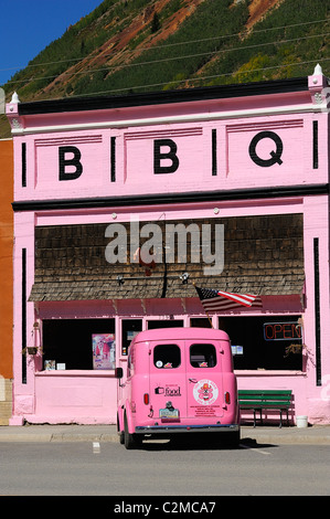 Pink car outside a pink BBQ restaurant on Blair Street, Silverton city, Silverton in the mountains of Colorado, - Stock Photo