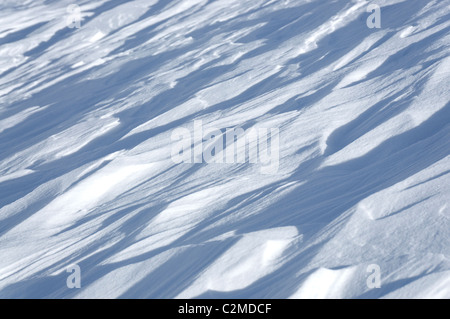 Wind packed snow, seen whilst ski touring on the Pointe Marcel Kurz, above Col Collon in the Central Valais, Switzerland. - Stock Photo
