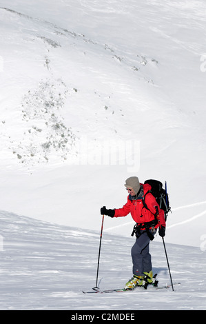 Ski touring on the Pointe Marcel Kurz, above Col Collon in the Central Valais, Switzerland. - Stock Photo