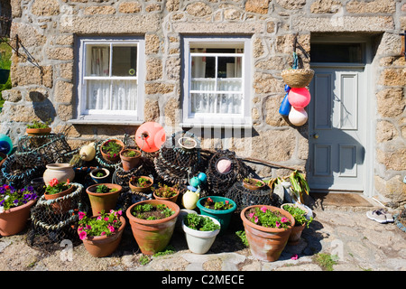 Crab pots outside a beautiful and traditional fishing cottage at Penberth, Cornwall, England, United Kingdom, UK, - Stock Photo