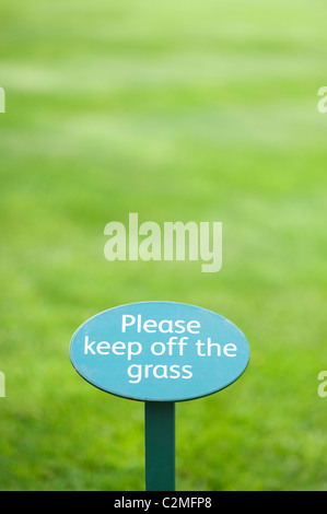 Please Keep off the grass sign - Stock Photo