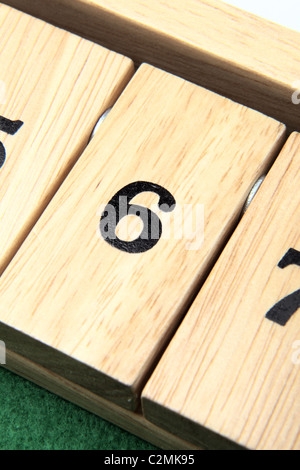 Number 6 on a wooden board game - Stock Photo
