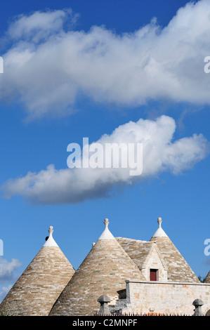 Alberobello. Puglia. Italy. Conical shaped rooftops of a trullo in the countryside between Locorotondo and Alberobello. - Stock Photo