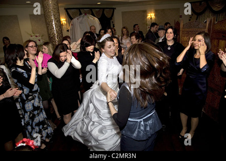 Bride at an Orthodox Jewish wedding in Brooklyn, New York. - Stock Photo