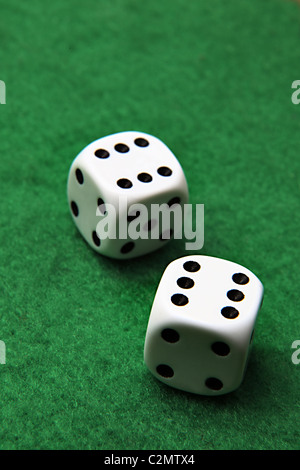 Double six on a pair of dice sitting on green felt - Stock Photo