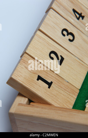 Numbers 1-4 on a wooden board game - Stock Photo
