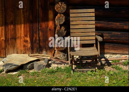 An old wooden folding chair at a mountain hut, Kleinsteg, Liechtenstein FL - Stock Photo
