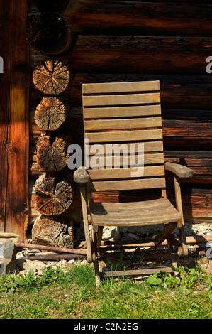An old wooden folding chair at a mountain hut in Kleinsteg, Liechtenstein FL - Stock Photo