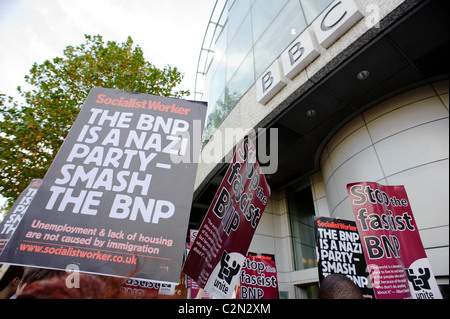 Demonstrations are held outside the BBC headquarters in protest against the BNP's leader Nick Griffin. - Stock Photo