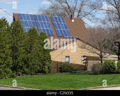 Solar panels on a house in suburban New Jersey, USA - Stock Photo