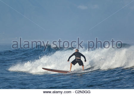 Surfing at Ho'okipa Bay on the island of Maui in the State of Hawaii USA - Stock Photo