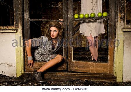 Caucasian Fashion Models in Burnt Building - Stock Photo