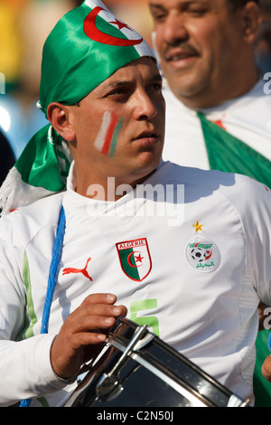 An Algeria supporter with a drum in the stands at a 2010 FIFA World Cup Group C match between Algeria and the United - Stock Photo
