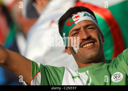 An Algeria supporter in the stands at a 2010 FIFA World Cup Group C match between Algeria and the United States - Stock Photo