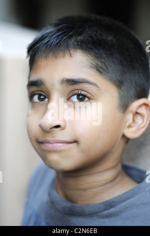 an handsome young indian man posing for the camera - Stock Photo