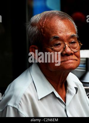 thai chinese man lost in his thoughts , emotions and expressions , everyday life, bangkok story, bangkok, thailand - Stock Photo